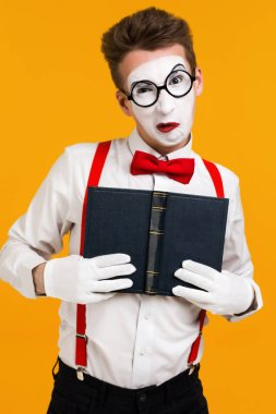 portrait of mime man artist with book
