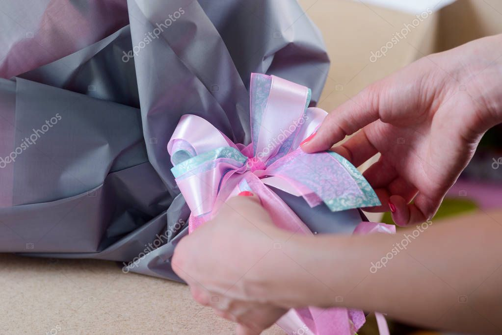 Female florist preparing a bouquet