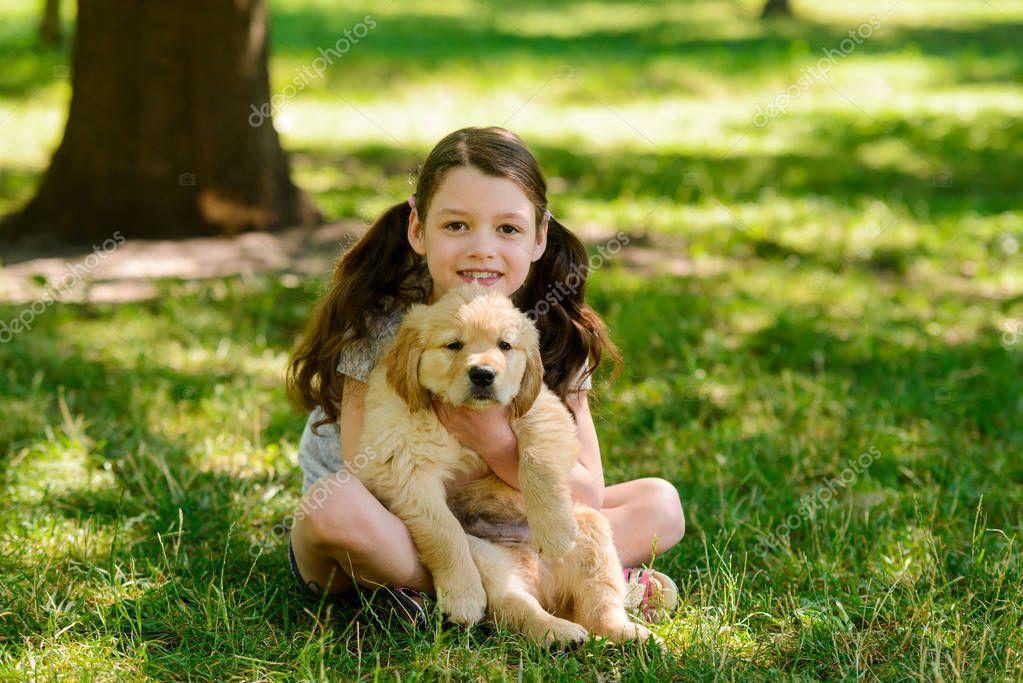 Bikini girl holding puppy, lesbian fertility clinics