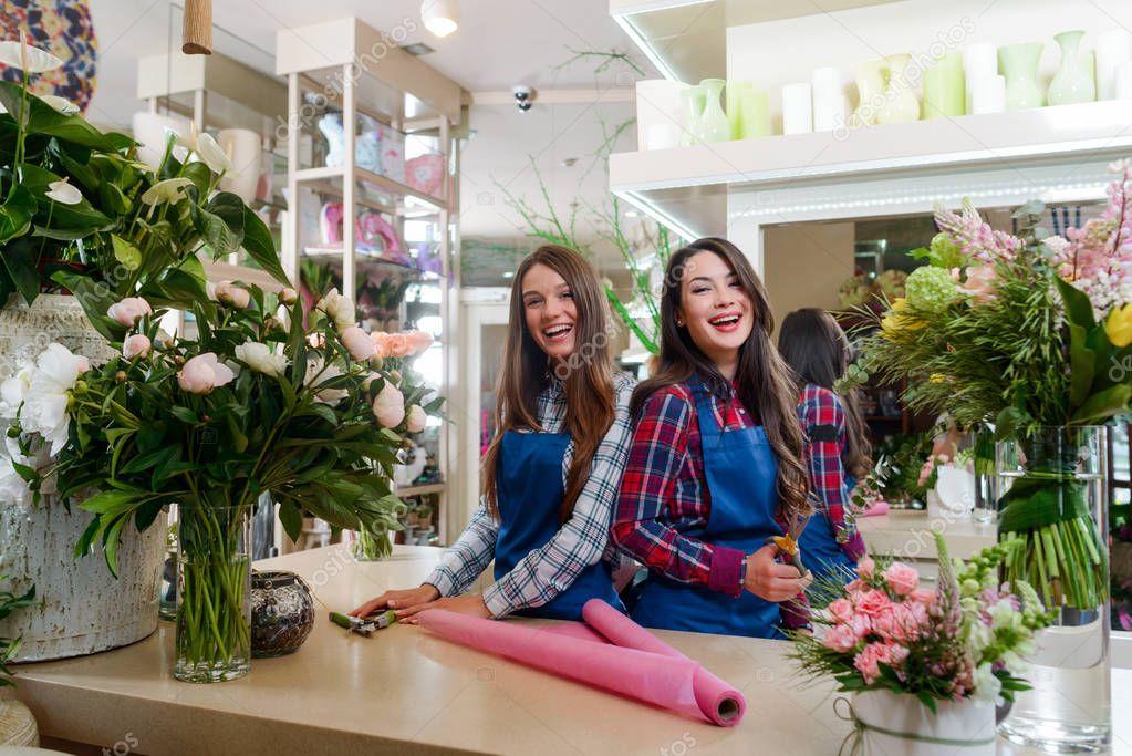 Happy workers in flower shop