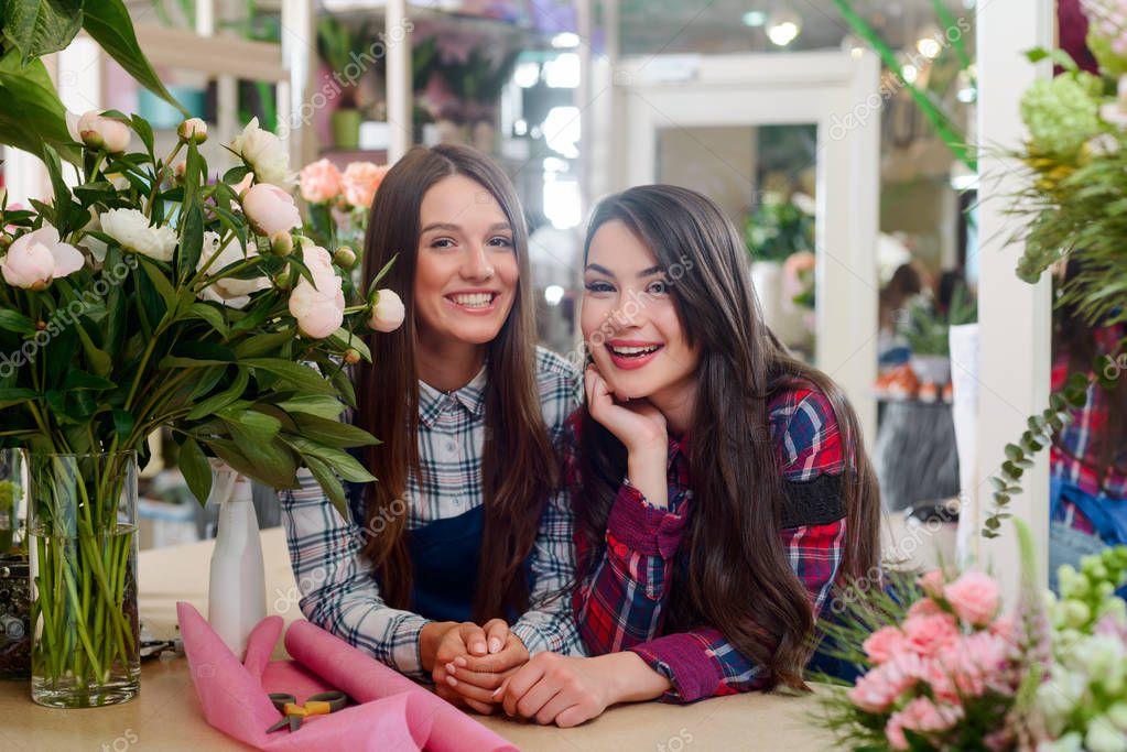 Smiling florist and shop assistant