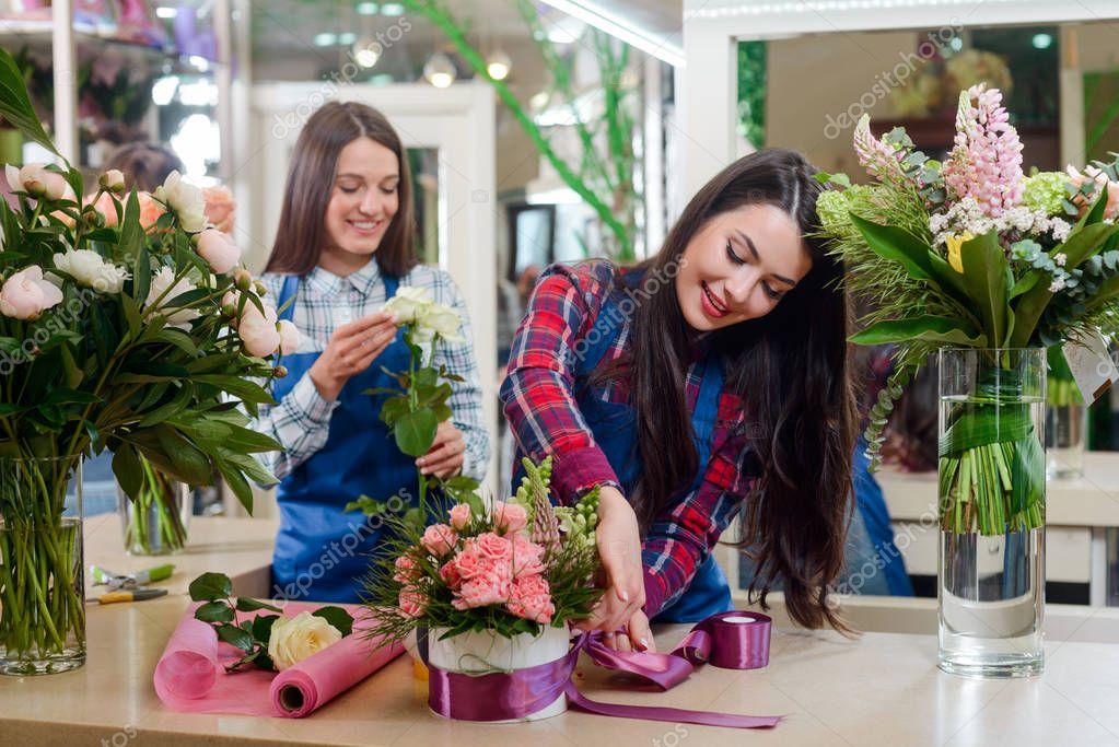 Florist decorating a flower box