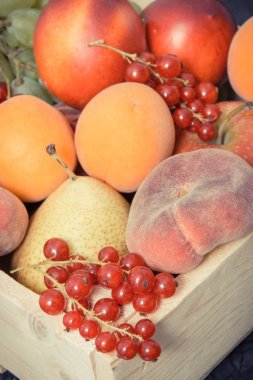 Heap of fruits in wooden box as healthy snack or dessert containing natural vitamins