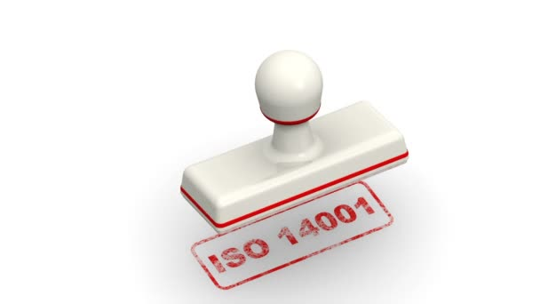 ISO 14001. The stamp leaves a red imprint ISO 14001 (ISO 14001 sets out the criteria for an Environmental Management System (EMS)) on white surface. Footage video