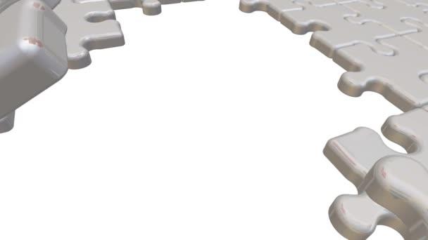 Týmová práce. Nápis na chybějící část skládačky. Skládací bílá puzzle prvky a jeden červený s textem týmové práce. Záznam videa