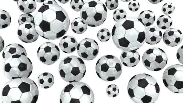 A focilabdák fehér alapon forognak. Sok fekete-fehér focilabda forog fehér alapon. Videoklip