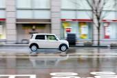 Fotografie jízdy v prší den