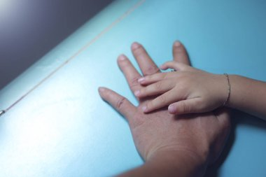 young kid hand on father hand