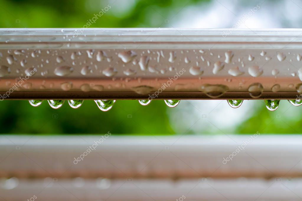 raindrops on a clothes line on a rainy day.