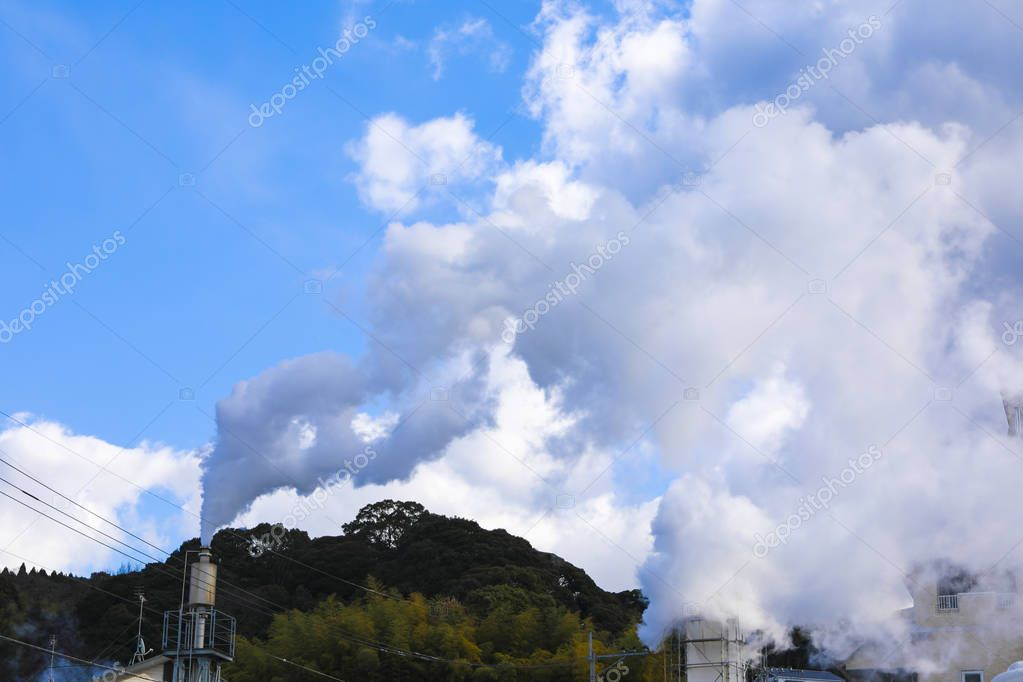 Hot steam tears out of the chimney from hot spring bathhouses at Beppu,Oita,Kyushu,Japan