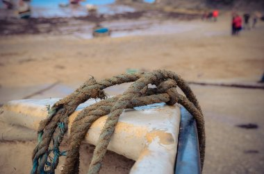 A close up of a boat and its tow rope at Port Issac Harbour in Cornwall
