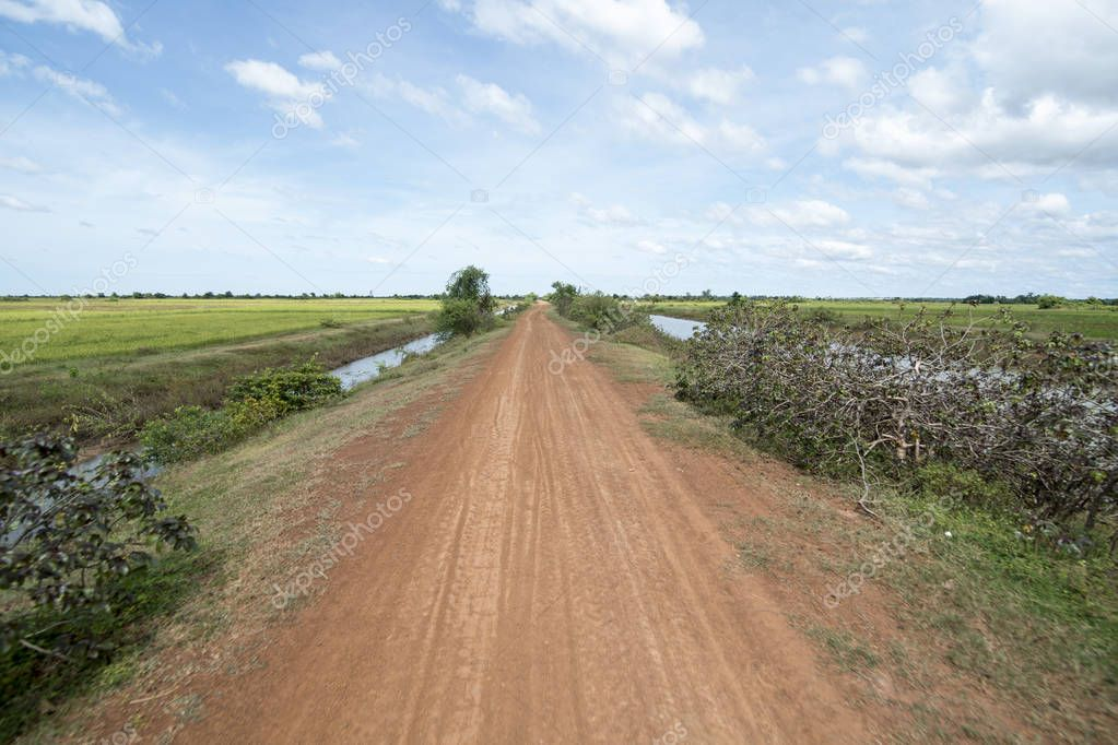 Water Khmer Management System and canal in the fields and landscape near the city of Kampong Thom of Cambodia