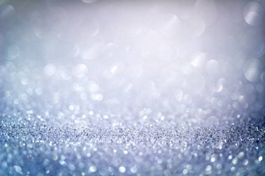 Abstract blue glitter bokeh background with shimmering light bubbles