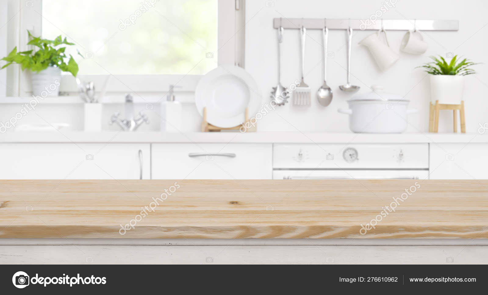 Wood table top on blur kitchen room and window background 9
