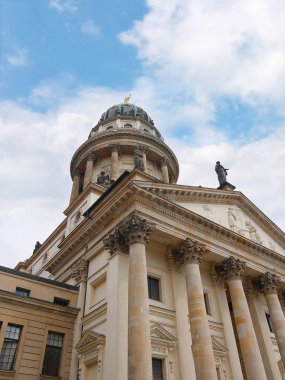The Gendarmenmarkt is arguably Berlin's most magnificent square. It is best known for the architectural trio composed of the German and French cathedrals (Deutscher und Franzsischer Dom) and Schinkel's Konzerthaus. The square dates back to 1700.