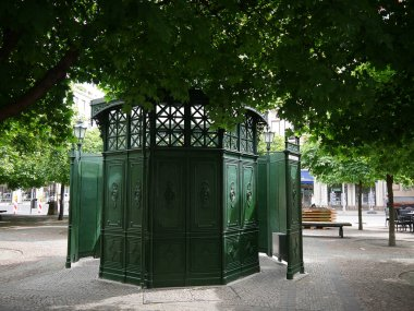 Cast iron Toilet (Pissoire) in the street outside the French church in the Gendarmenmarkt area of Berlin. The Gendarmenmarkt is a square in Berlin and the site of an architectural ensemble including the Konzerthaus and the French and German Churches