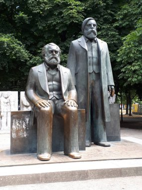 Statues of Marx and Engels near Alexanderplatz in what was Soviet East Berlin. They were alumni of the Humboldt University. They both died and are buried in London. These statues are in what was the Soviet Sector of Berlin. stock vector