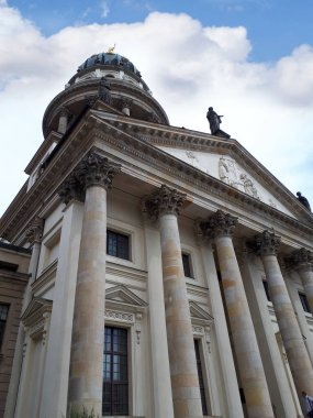 The Gendarmenmarkt is a square in Berlin and the site of an architectural ensemble including the Konzerthaus and the French and German Churches