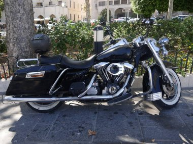 Motorcycle taking partin the Festival of Speed car rally on the island of Rhodes in the Greek Dodecanese Islands