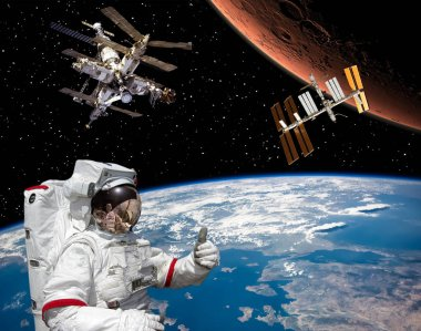Astronaut shows the thumbs-up about flying to Mars. Space statio