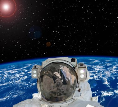 Astronaut and earth on the backdrop. The elements of this image