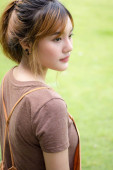 Beautiful young adult thai chinese bronze hair relax and smile