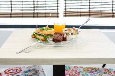 delicious healthy breakfast on wooden table in bar