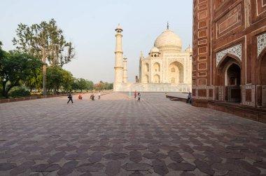 Agra, India - 5 May 2015: Tourists walk around the iconic mausoleum in the Taj Mahal complex, Agra, India