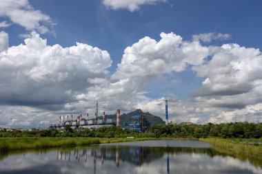Thai Power plant under blue cloudy sky stock vector