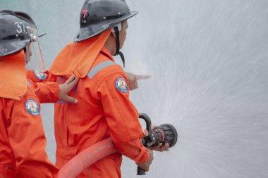 Firefighters spraying water in LPG gas tanks