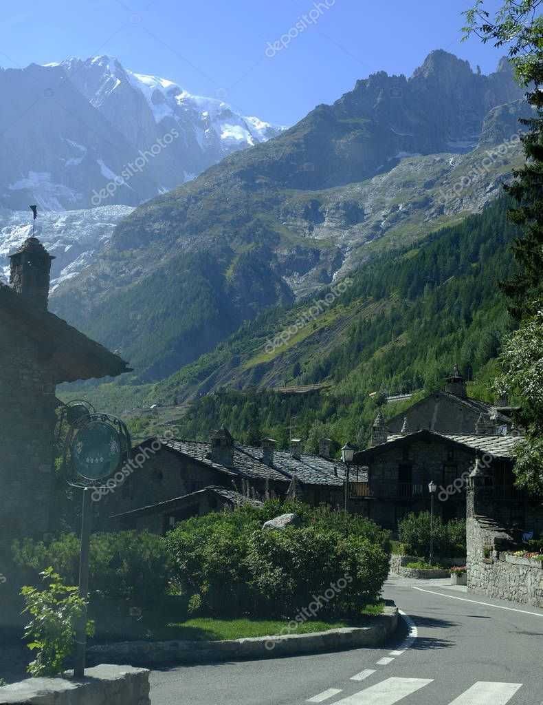 The Entreves a beautiful village with new Skyway Monte Bianco mountain cable car. Courmayeur, Italy.
