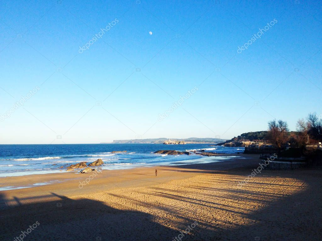 Desert beach and clear sky in Santander, Spain.