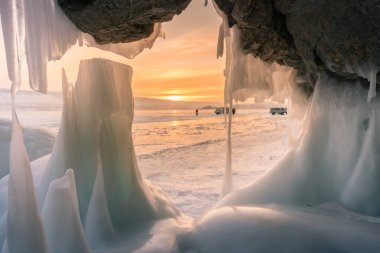 Ice cave with sunest background, Baikal Siberia Russia winter season natural landscape background