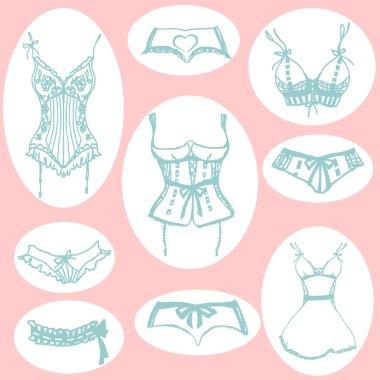 set of blue lingerie on pink background