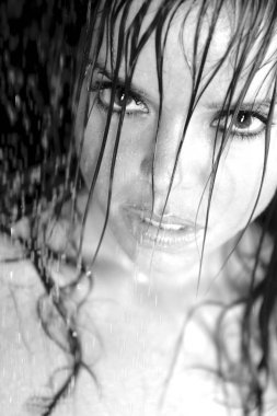 Face closeup of pretty lovely girl in shower monochrome