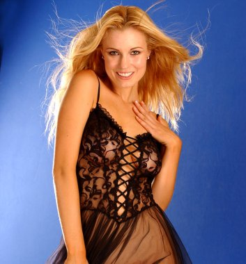 Black sheer lace teddy nightgown on stunning beautiful blonde haired woman - blue copy space