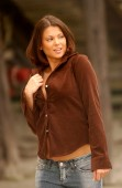 Passive look - looking away from camera - Brown soft felt long sleeve cute top on large breasts and blue jeans  Professional fashion model  - Tan tone clear skin - pretty face