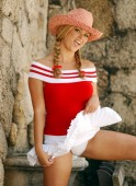 Photo Ponytails and cowboy hat on adorable blonde - red stripped shoulder less sweater   White pleated skirt - Cotton panties  Naughty School Girl - Naughty Cowgirl - Naughty Cheerleader - Wind blown Up skirt - Up-skirt - happy fun loving gal lifts skirt