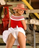Ponytails and cowboy hat on adorable blonde - red stripped shoulder less sweater   White pleated skirt - Cotton panties  Naughty School Girl - Naughty Cowgirl - Naughty Cheerleader - tone butt cheeks backside rear end behind view of curved buttocks