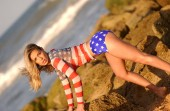 Photo Landscape red white and blue American Flag outfit on busty brunette independence and freedom lifestyle