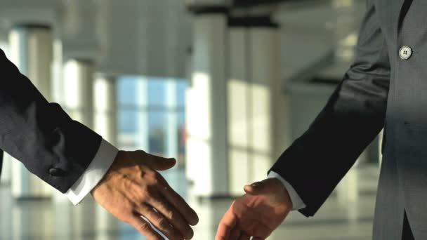 The two businessmen handshake. slow motion