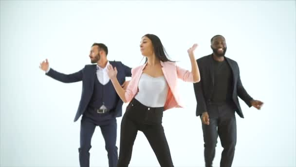 The three people dancing on the white background. slow motion