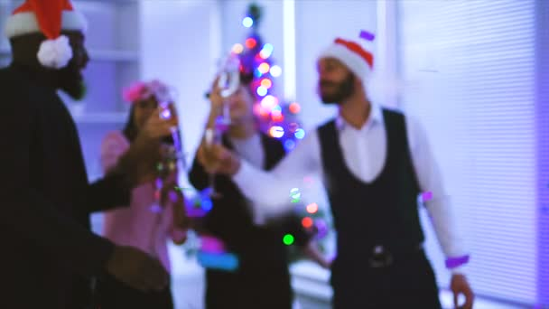 The four people celebrating christmas in the office. slow motion