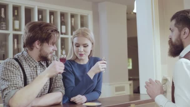 Couple in love. Handsome man flirting with cute woman in restaurant. Bearded man flirting with young sexy blonde