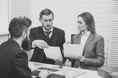 Business partners, businessmen at meeting, office background. Business negotiations concept. Business negotiations, discuss conditions of deal, contract. Woman lawyer explain terms of transaction.