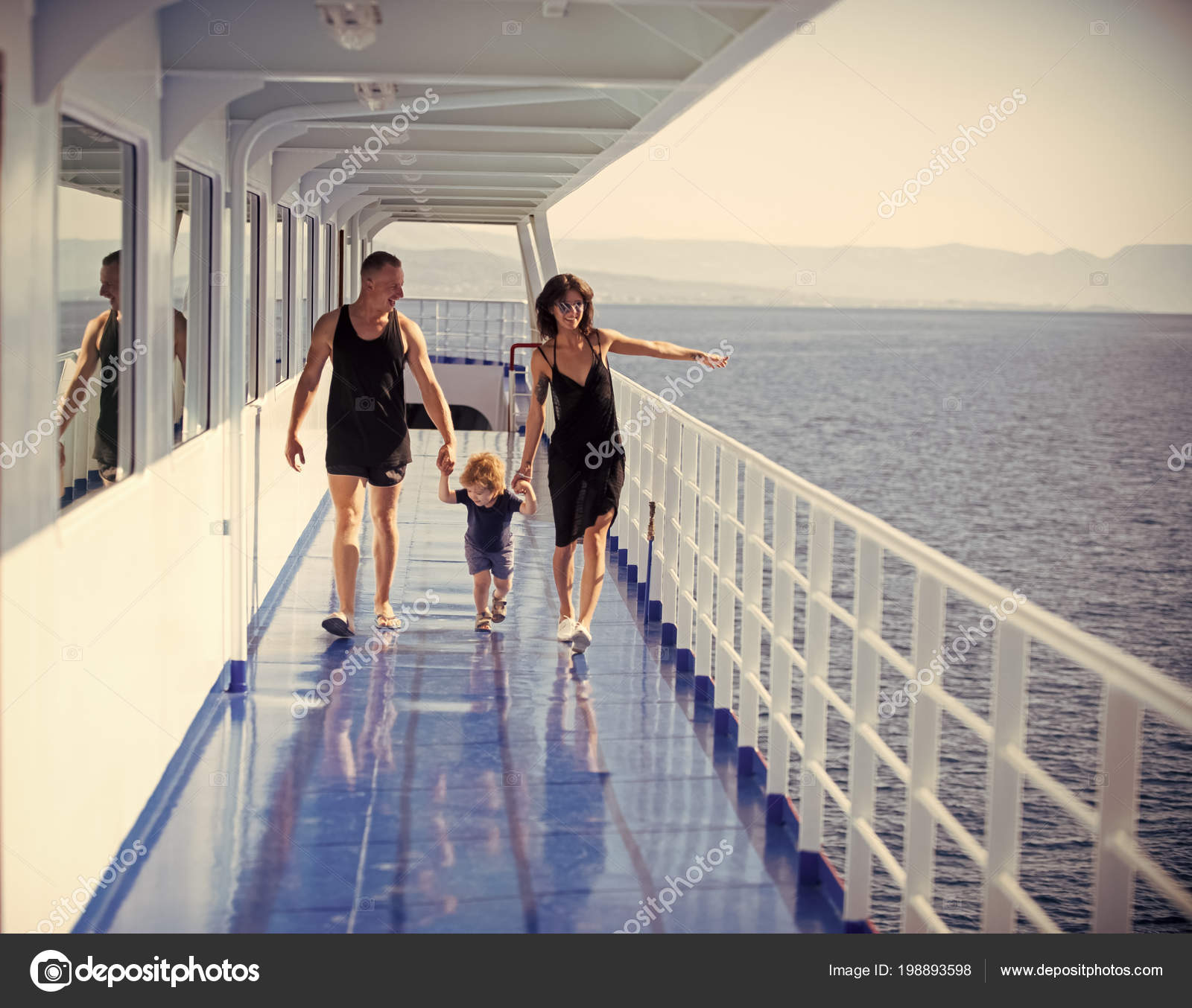 b69529436b3 family holiday. Happy family with cute son on summer vacation. Family  travelling on cruise ship on sunny day. Family rest concept. Father