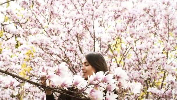 Woman in a blooming garden . Fashion, Cosmetics Perfumes.
