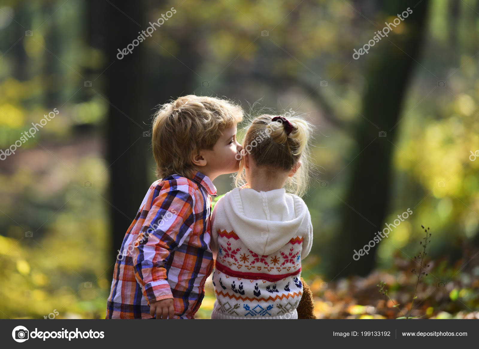 Little Boy Kiss Small Girl Friend In Autumn Forest Brother Kiss
