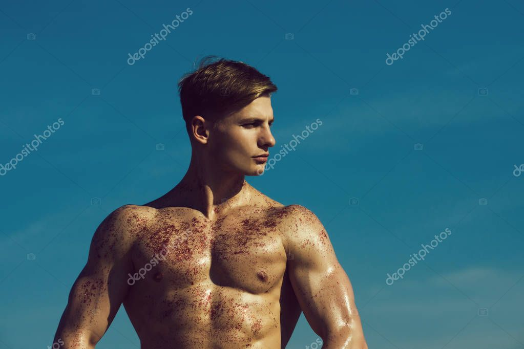 Gladiator or atlant. Man with muscular wet body.