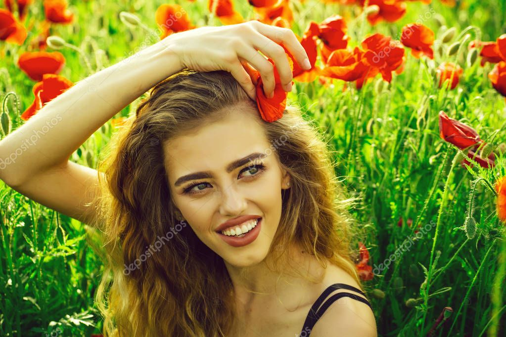 womans happiness. pretty woman or happy girl in field of poppy seed